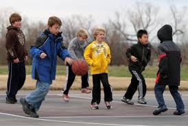 photo of boys playing ball