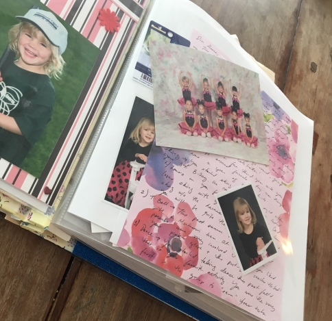 Image of book filled with letter, photo, etc